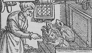 An elderly witch feeds her satanic 'familiars'