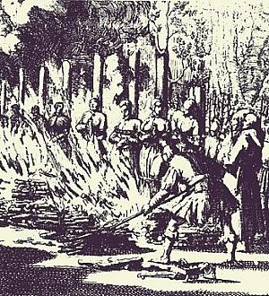 Condemned female witches are burned at the stake.